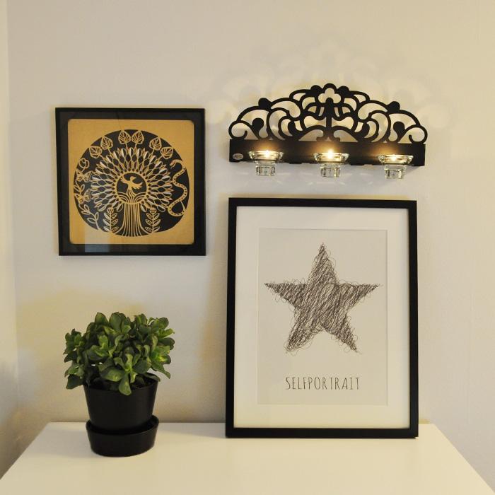 Stil, svart ljushållare för vägg.
