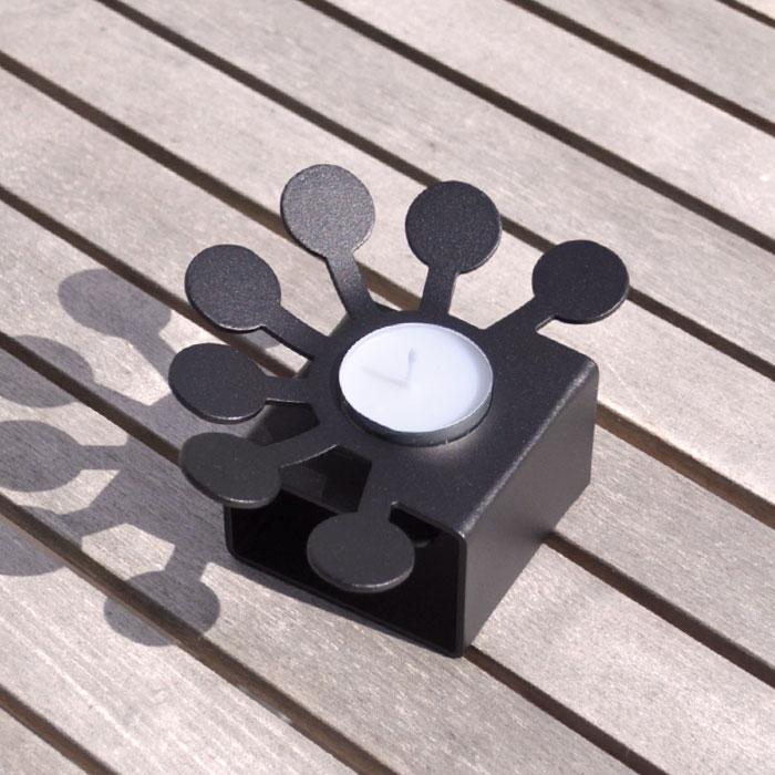 Blomma, svart. Ljushållare för värmeljus